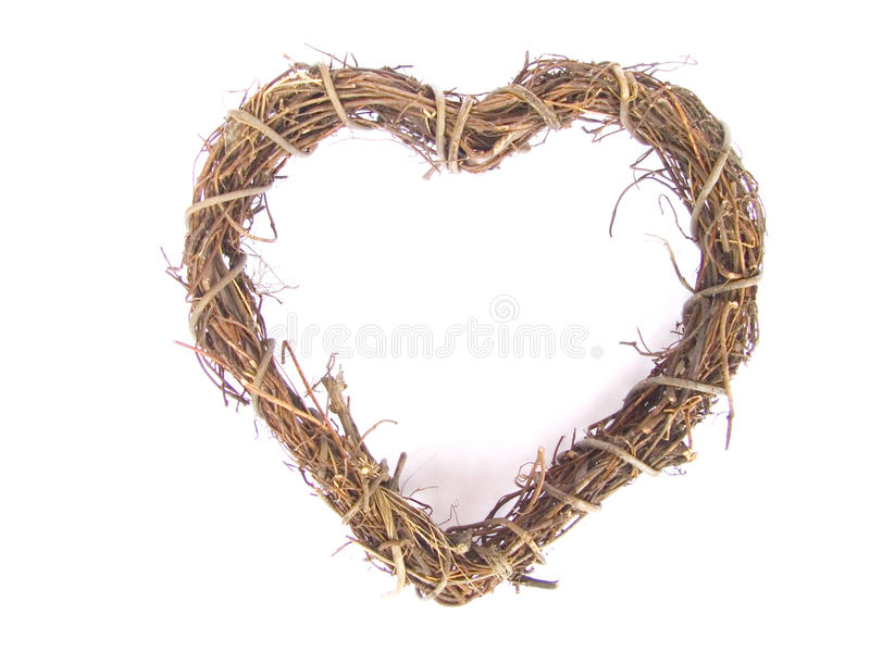 Heart shaped willow wreath. On white background royalty free stock image