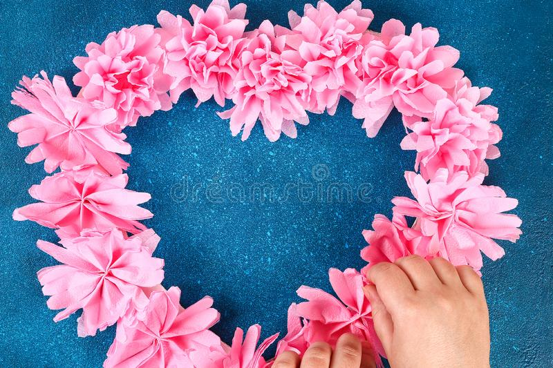 Heart shaped wreath decorated artificial flower made pink tissue paper napkins stock photos
