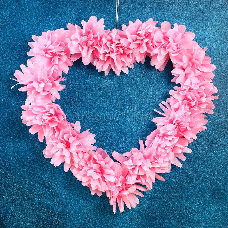 Heart shaped wreath decorated artificial flower made pink tissue paper napkins royalty free stock images
