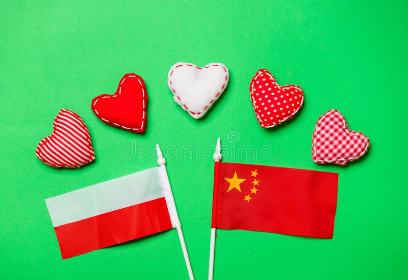 Heart shapes and flags of Poland and China royalty free stock images