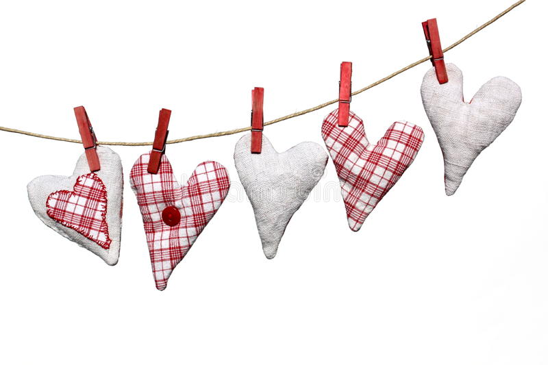 Heart shapes on washing line royalty free stock photos