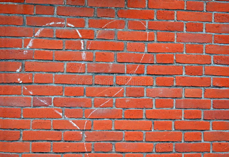 Heart sign drawn by white chalk on red brick wall, royalty free stock photo