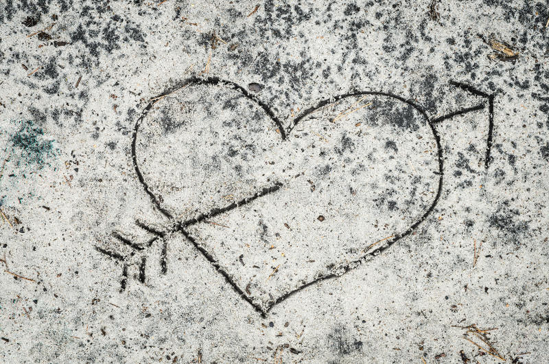 Heart sign pierced by arrow stock images