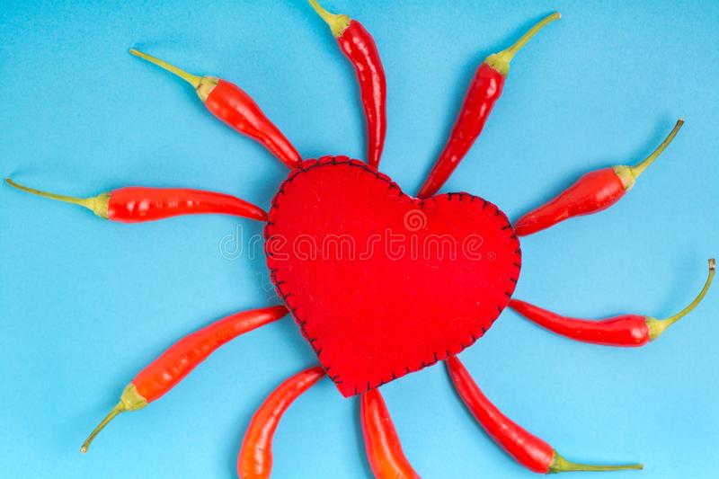 Heart sign with red pepper royalty free stock photography