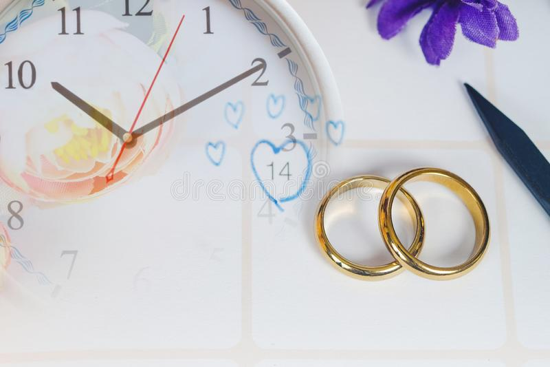Heart sign to Reminder Wedding day in calendar planning and pen. With clock stock photos