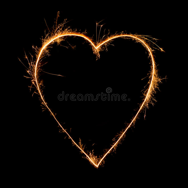 Heart of sparkler on black background royalty free stock photo