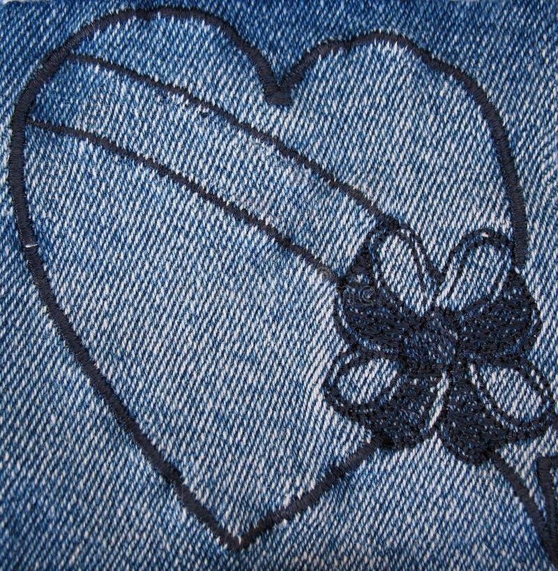 Heart stitched on denim stock photo