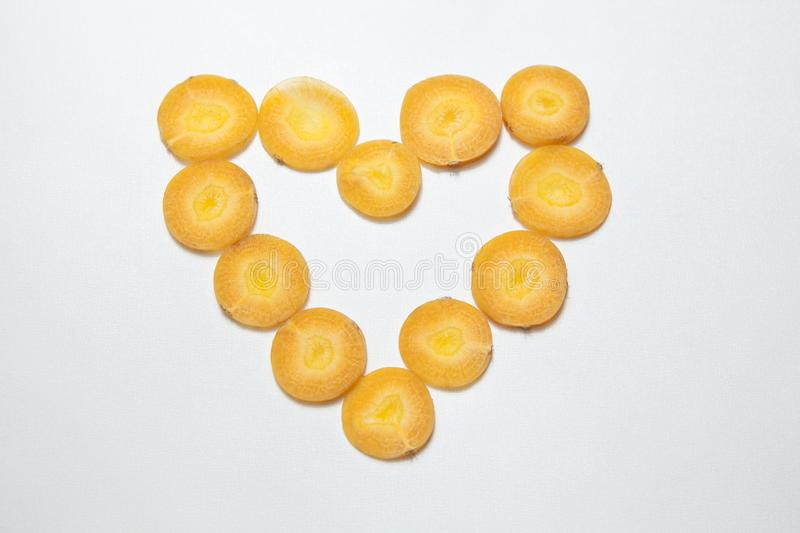 Heart symbol carrot white background royalty free stock photography