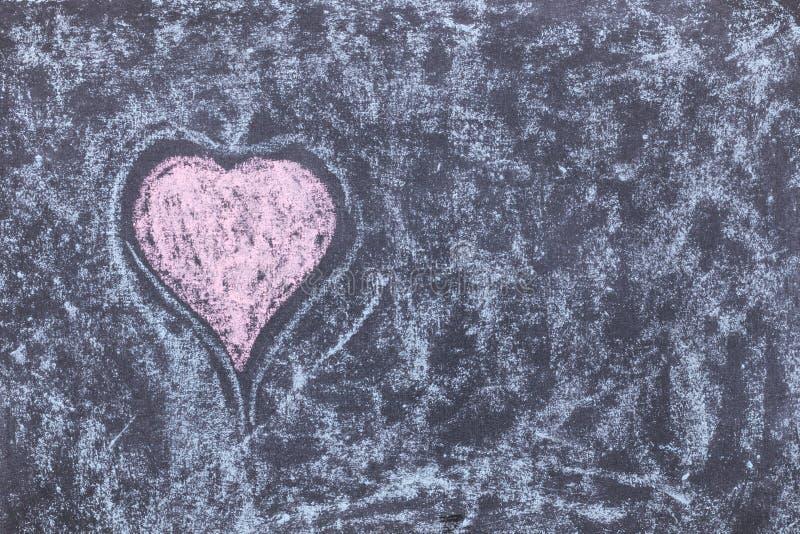 Heart symbol. Chalk drawing on blackboard. Multi colored inscription stock images