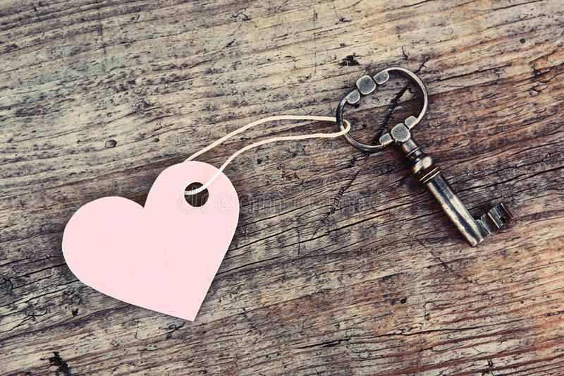Heart symbol on key tag. Concept of love, romance and vintage lifestyle.  stock images