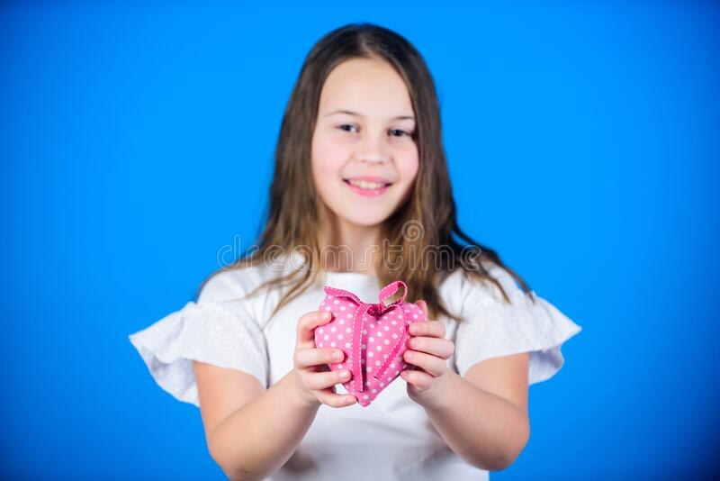 Heart symbol of love. Kid adorable girl happy face show heart blue background. Celebrate valentines day. Love holiday royalty free stock image