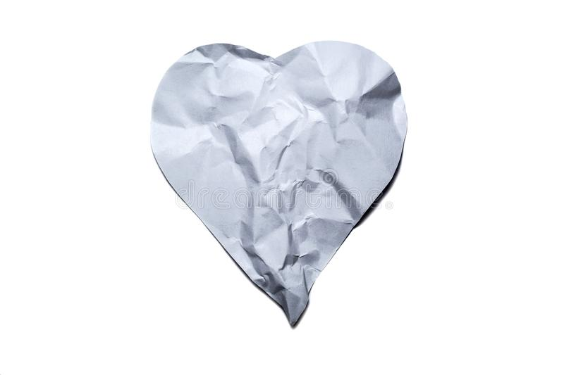 Heart symbol from old, crumpled paper isolated on a white background stock photos