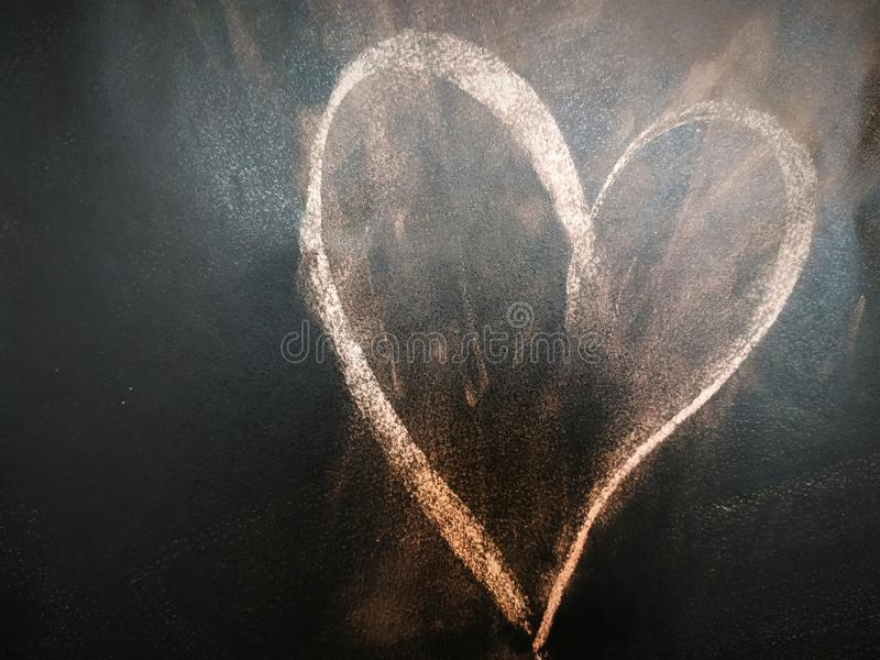 Heart on the blackboard. Heart symbol was drawing on the blackboard. Kids drawing love symbol to the teacher or mother royalty free stock photos