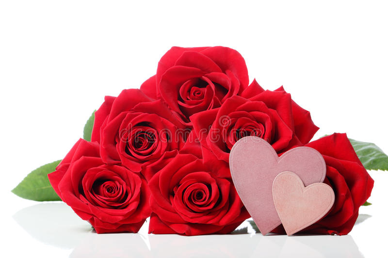 Heart tags with red roses. Over white background stock photos