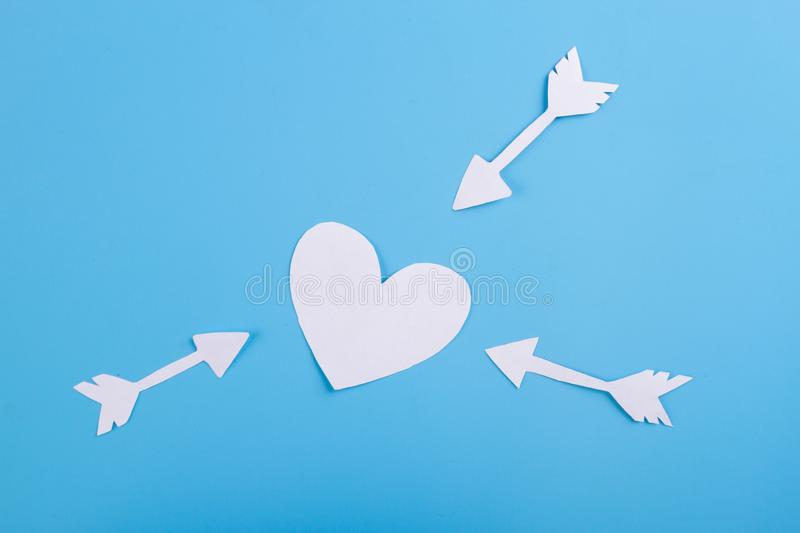 Heart and three arrow. On blue background stock images