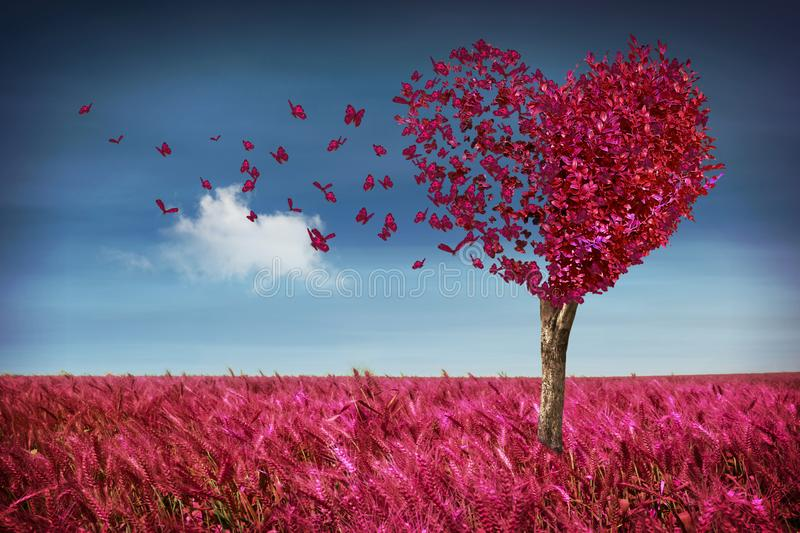 Heart tree with butterflies and meadow royalty free stock image