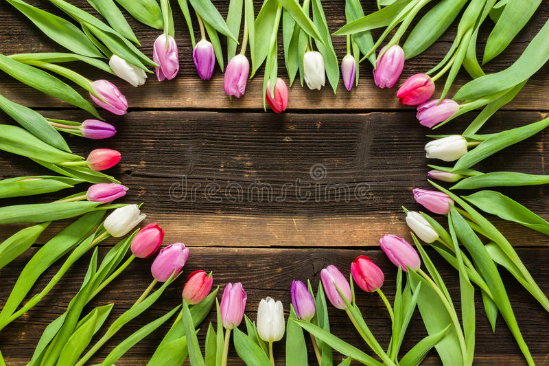 Heart from Tulips Flowers on rustic table for March 8, International Womens Day, Birthday , Valentines Day or Mothers day - Close stock image