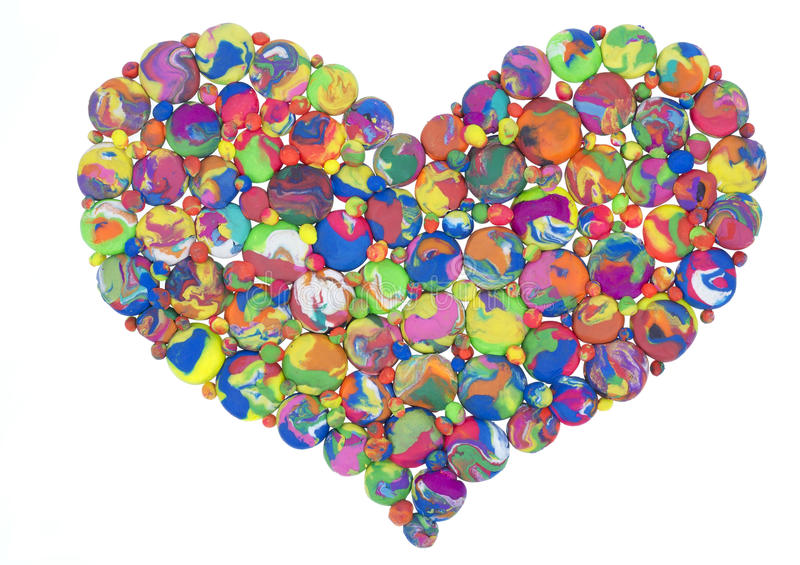 Heart of the universe. The heart of the universe concept is made of clay pellets and crumbs, which are similar to the planets and satellites Isolated plasticine stock images