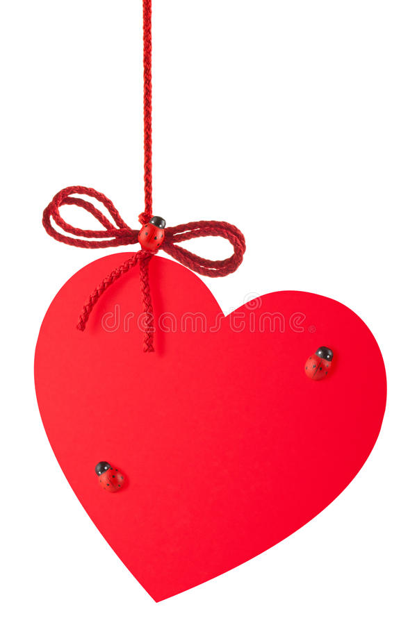 Heart-Valentine with a rope bow and toy ladybugs royalty free stock photos