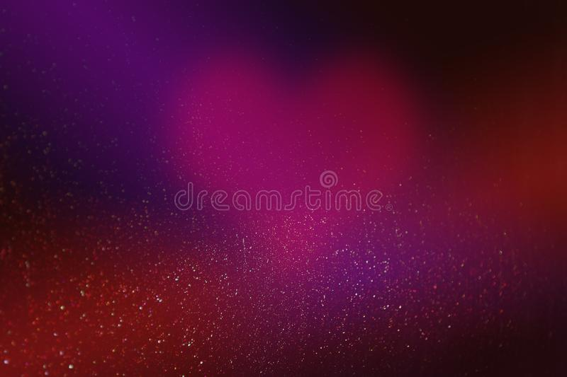 Heart for valentines day in abstract red background with glowing stars and bokeh in the form of design decoration. stock photography
