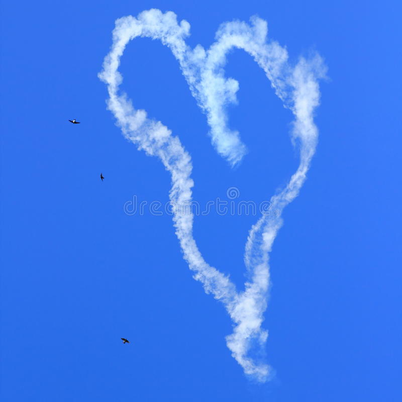 Heart Skywriting With Birds In Sky Stock Image