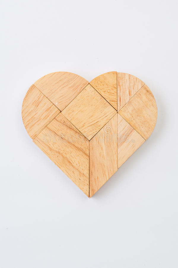 Heart version of tangram, a traditional Chinese Puzzle Game made. Of different wood parts to build abstract figures from them, isolated on white royalty free stock photography