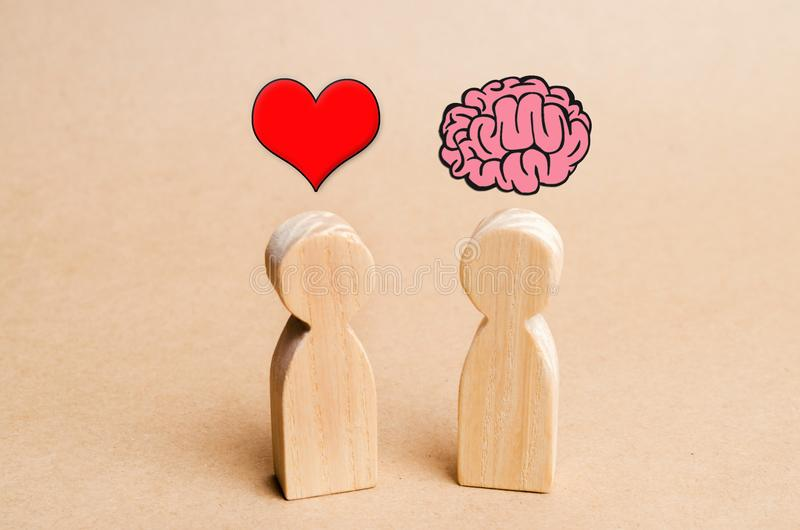 Heart vs Mind or brain. Concept of mind against love. Balance between irrational love and reason. Family psychology. Problems in r stock photo
