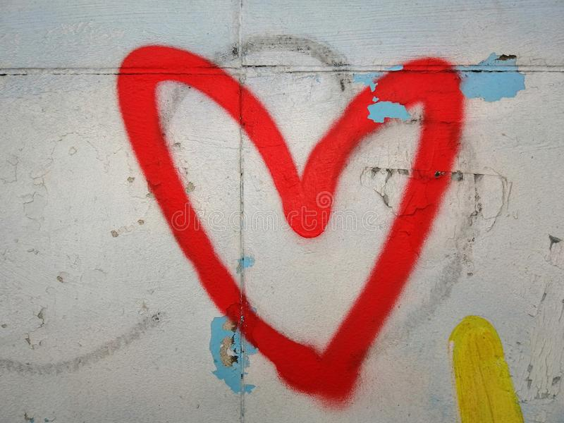 Heart on the wall, edging the heart royalty free stock image