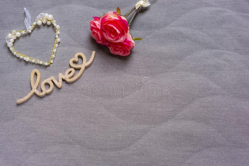 Heart with white pearls and love lettering with heart and roses royalty free stock photo