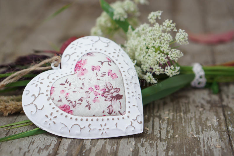Heart on a wooden background stock photos