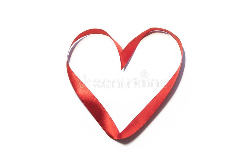 `Heart` written with red silk ribbon royalty free stock image