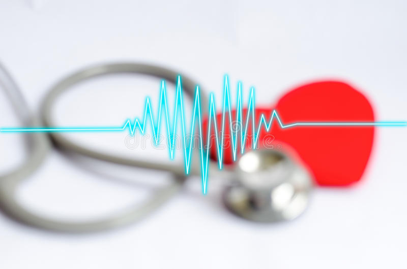 Heartbeat on blur Stethoscope with red heart background - Health royalty free stock photos