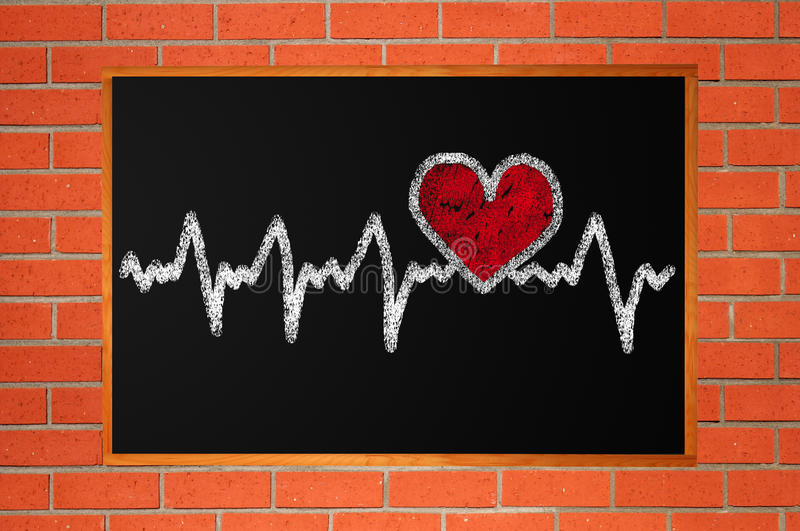 Heartbeat character and design, love heart on chalkboard. Heartbeat character and design, love heart on a chalkboard over orange brick wall stock image