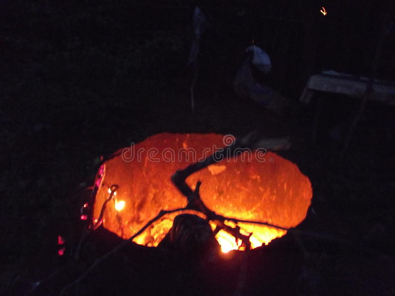 A fire in a barrel at night in the dark stock photos