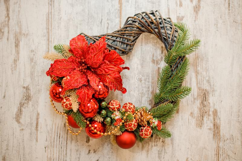 Hearth shape christmas wreath with golden and red decoration stock photo