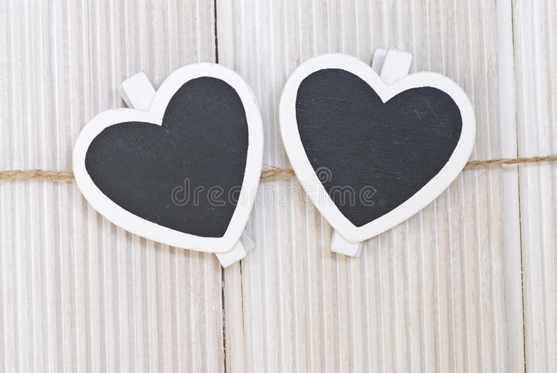 Hearts. With clothpins on a line stock photography