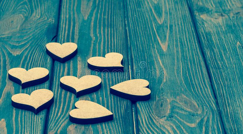 Hearts on the background of old wood. Romantic background stock image