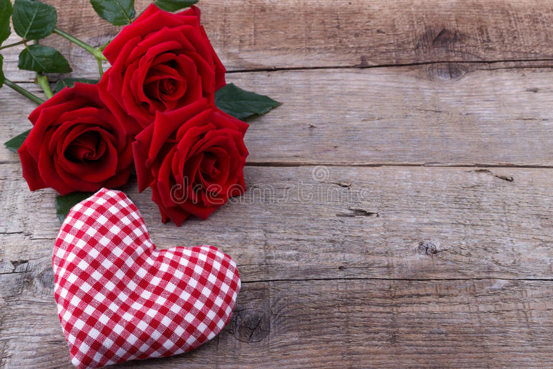 Hearts and a bouquet of red roses on wooden board, Valentines Da royalty free stock image
