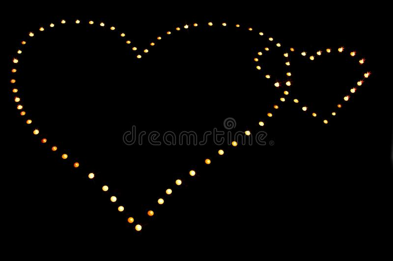 Hearts from candles royalty free stock photography