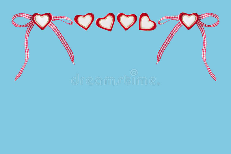 Hearts and checked loop. Before blue background royalty free stock image