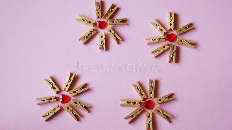 Hearts and clothespins. Today, most pegs are created very cheaply: two locking plastic or wooden prongs are created, which are often caught with a small spring royalty free stock photography