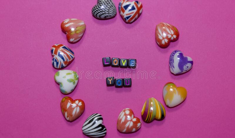 Hearts and declaration of love on a pink pastel background royalty free stock photo