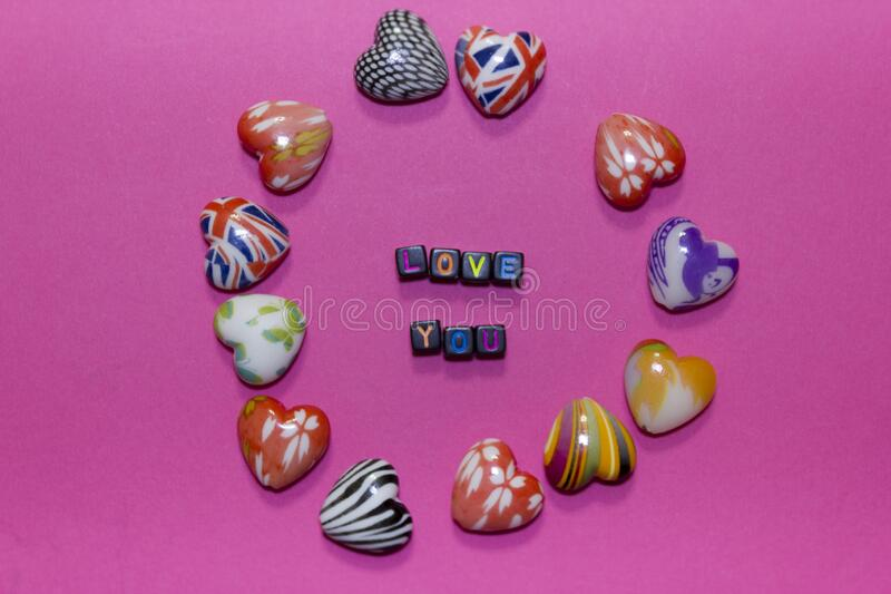 Hearts and declaration of love on a pink pastel background stock photos