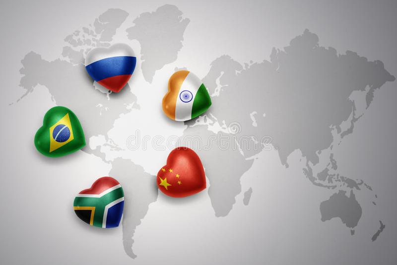 Hearts with flags of the five countries of the brics russia brazil hearts with flags of the five countries of the brics russia brazil india china south africa on a world map background concept gumiabroncs Choice Image
