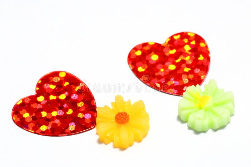 Hearts and flower. Two red hearts with reflective dots and flower object . Isolated on white background stock photos