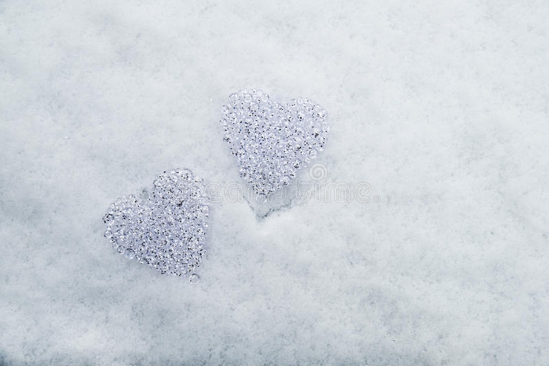 Hearts of glas in the snow royalty free stock images