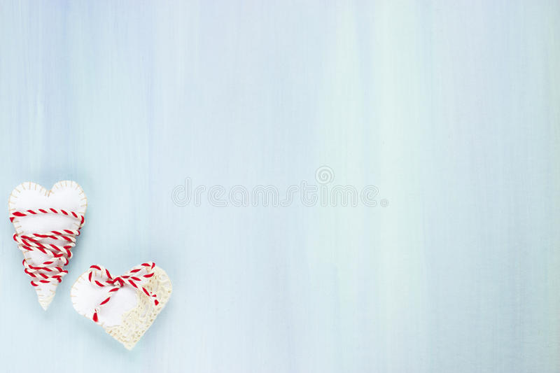 Hearts. Handmade Valentines day hearts on blue background royalty free stock images
