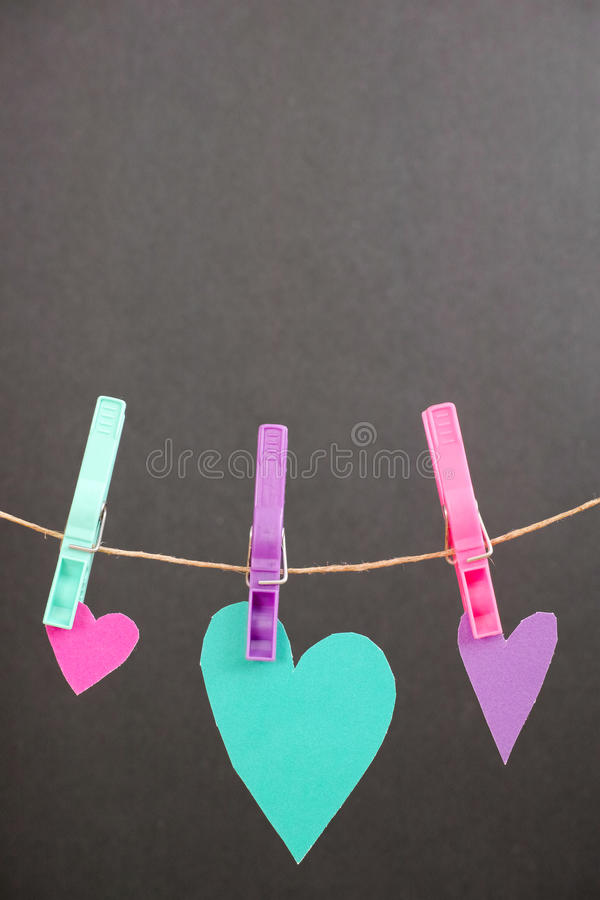 Hearts on the line. Real cut out of paper hearts on a rope for your romantic or healthcare copy - copy space above, focus is on the hearts royalty free stock photo