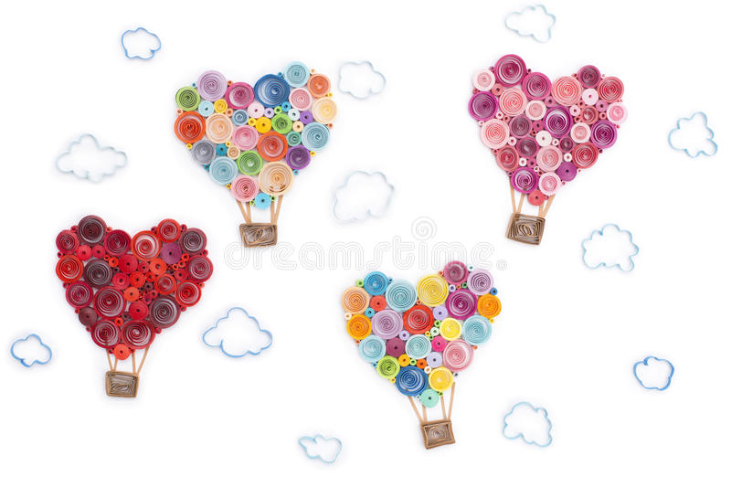 Hearts made in quilling art on white background stock image