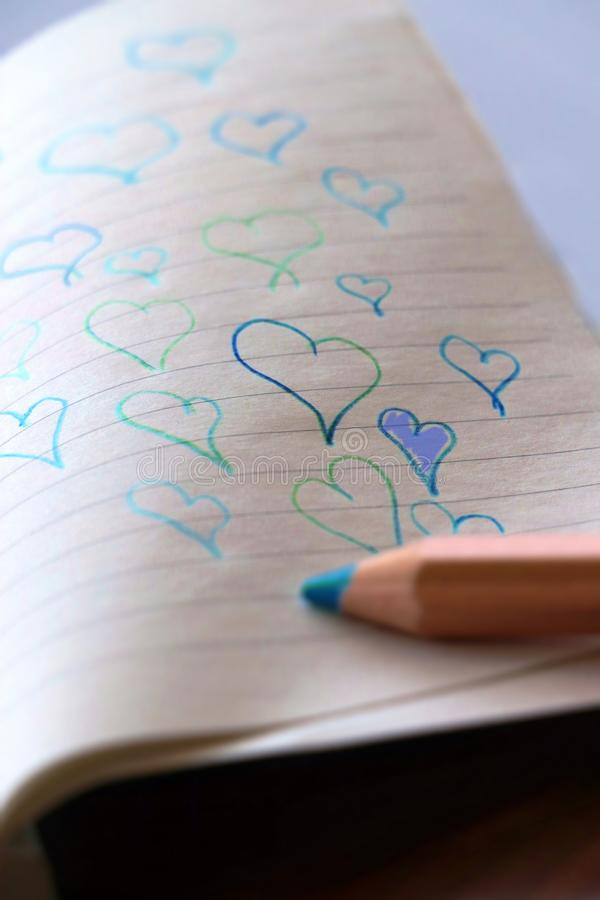 Hearts on Paper. Love Concept royalty free stock image